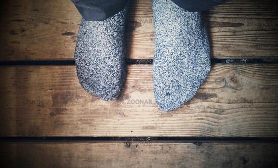 Feet on wooden floor, socks