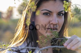 A Lovely Hispanic Model Travels Through The American Desert Enjoying The Winters Day