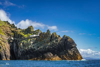 Skellig Lighthouse located on the edge of the cliff on Skellig Michael island