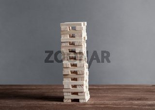 Tower from wooden blocks standing on table
