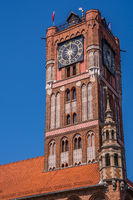 Low angle shot of the Clock Tower of Ratusz building in Torun, Poland