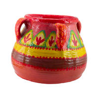 Pink handmade artistic pained colorful pottery vase isolated on white including clipping path