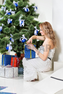 woman opens a Christmas present