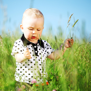 boy joy in green grass