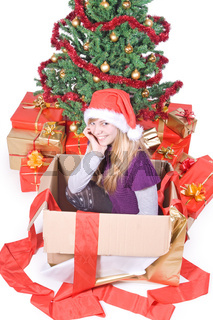 Girl in a box with Christmas tree