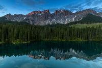 Summer morning at Lake Karersee in front of Latemar, Dolomites, South Tyrol