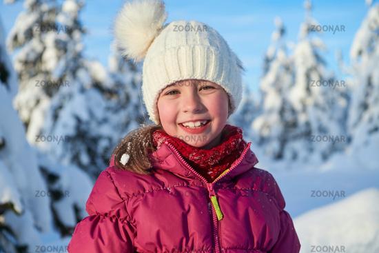 cute little girl on beautiful winter day
