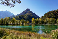 view of Lake Jasna with forest and mountain landscape in beautiful autumn colors