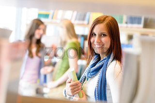 High school library student woman choose book