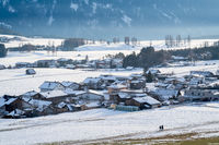 Walking in cold winter landscape in Wildermieming, Tirol, Austria