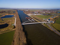 Pedestrian and cyclist bridge over a large water way in Nigtevecht The Netherlands. Liniebrug