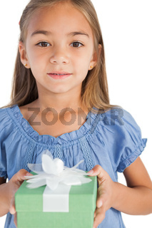 Portrait of a smiling little girl holding a wrapped gift