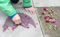 Child paints flower with flowers