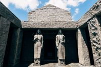 Entrance to the mausoleum of Peter II Petrovic Njegos with two tall statues, on top of Mount Lovcen, Montenegro.