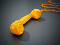 Yellow vintage phone receiver and wire isolated on gray background. 3D illustration