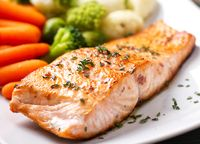 Salmon Fillet with Mixed Steamed Vegetables. High quality photo.