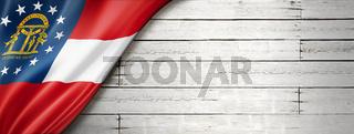 Georgia flag on white wood wall banner, USA