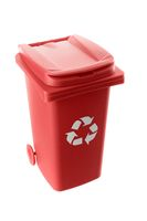 Plastic red trash can isolated on white background