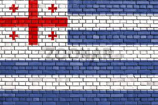 flag of Adjara, Georgia painted on brick wall