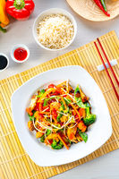 sweet and sour chicken with rice and vegetables