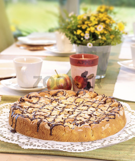 Apple cake on tea table