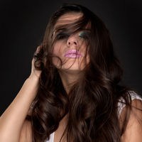 Young brunette woman with very beautiful long hair