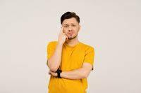 Confusion or disappointment, facepalm handsome young man on his face. Young casual man in yellow t-shirt portrait isolated on white background. Human emotions, facial expression concept