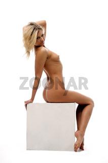 Beautiful naked woman in the studio