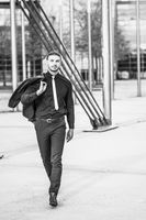 Handsome stylish young businessman posing outdoor portrait