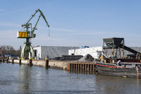 Crane and transport ship at the harbor of the, Datteln-Hamm-Canal, Luene, Ruhr area,