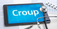 The word Croup on the display of a tablet