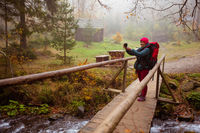 Woman is taking a selfie while hiking in the forest