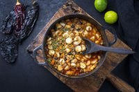 Traditional slow cooked Mexican pozole rojo soup with ground minced beef