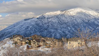 Pano Large houses on top of a snowy hill with Mount Timpanogos view at Draper, Utah