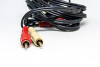 Two red and white audio RCA plugs isolated on a white background. Analog technology