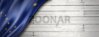 Alaska flag on white wood wall banner, USA