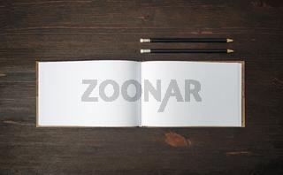 Blank sketchbook, pencils