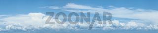 Blue cloudy sky. Panoramic shot.