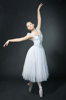 Beautiful girl dances in a ballet dress, on pointe