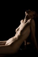 Sensual naked woman relaxing on couch