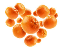 Oranges in the shape of a heart on a white background