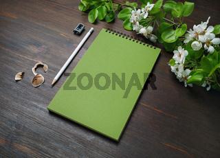 Notepad, pencil, sharpener, flowers
