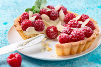 Homemade shortbread pastry with cream and raspberries.