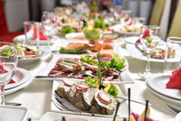 Banquet table with delicious food in a restaurant. Professional and exquisite dish serving at restaurant. Catering service
