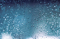 Rain drops on the window, rainy night with cool lights. Drop pattern.