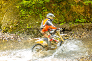 Enduro in the Summer Sunny Forest and Spray