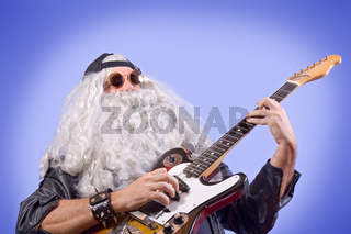 Rocker-man with the guitar on blue background