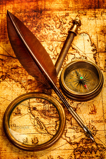 Vintage items on ancient map.