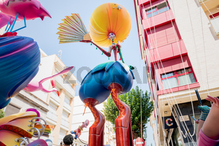 Large modern cartoon paper mache statue with high heels made for the Fallas celebration in 'Carrer Magistrat Catala' in Gandia, Spain