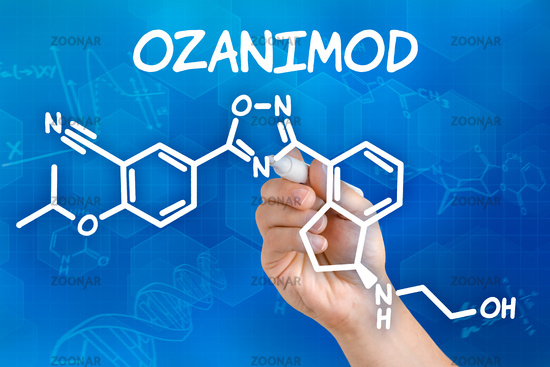Hand with pen drawing the chemical formula of Ozanimod